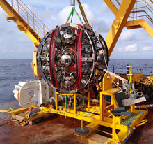Deep-sea deployment of the KM3NeT neutrino telescope detection units by self-unrolling